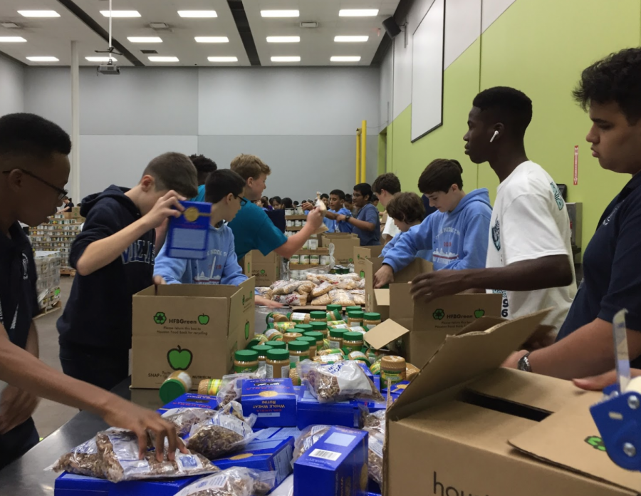 9th graders swiftly organizing boxes of food to be sent to communities in need for the holidays.