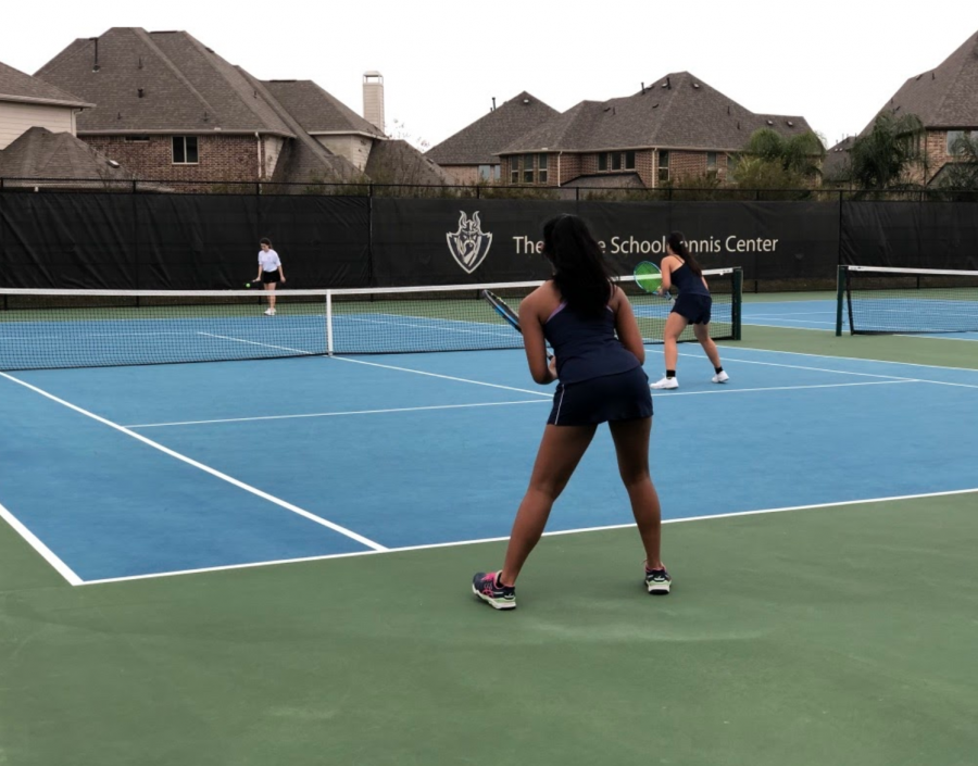 [Left to right] Meghna Prabhakaran (9) and Melania Shen (9) playing girls line one doubles