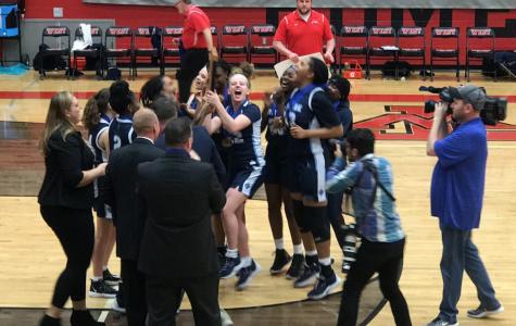 The Village School's Girls' Basketball team celebrating their championship win