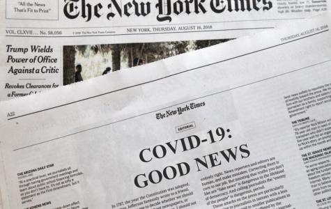 A newspaper detailing good news on the novel coronavirus