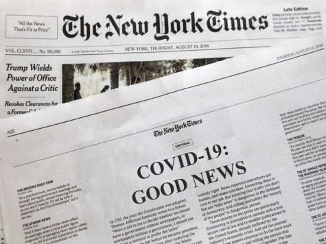 A newspaper detailing good news on the novel coronavirus