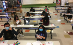 Image of students at The Village School writing holiday cards for local hospitals and nursing homes.