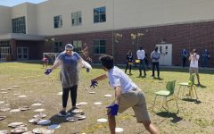 Resul Ovezov (11) throwing a pie at Dr. Hennessy, with VHS students and staff in the background enjoying the festivities.