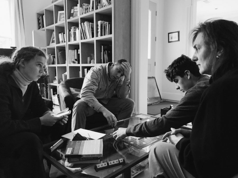 """SCRABBLE! Eleonore Shaw, Will Shaw, Raphael Berbain, and Christine Berbain play scrabble. While the power was out, they also played other games such as Uno and Poker. """"Although not having power is complicated, it forced us to not be on our phones,"""" said Eleonore Shaw. """"I felt like I spent more time with the people living the in the house."""""""